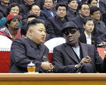 TOPSHOTS  This photo taken on February 28, 2013 and released by North Korea's official Korean Central News Agency (KCNA) on March 1, 2013 shows North Korean leader Kim Jong-Un (front L) and former NBA star Dennis Rodman (front R) speaking at a basketball game in Pyongyang. Flamboyant former NBA star Dennis Rodman has become the most high-profile American to meet the new leader of North Korea, vowing eternal friendship with Kim Jong-Un at a basketball game in Pyongyang.  AFP PHOTO / KCNA   ---EDITORS NOTE--- RESTRICTED TO EDITORIAL USE - MANDATORY CREDIT