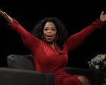 Oprah Winfrey acknowledges the audience after she came to the stage for an interview with Ball State University alumnus David Letterman, host of CBS's