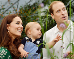 LONDON, ENGLAND - JULY 02:   (EDITORIAL USE ONLY) Catherine, Duchess of Cambridge holds Prince George as he and Prince William, Duke of Cambridge's look on while visiting the Sensational Butterflies exhibition at the Natural History Museum on July 2, 2014 in London, England. The family released the photo ahead of the first birthday of Prince George on July 22.  (Photo by John Stillwell - WPA Pool/Getty Images)