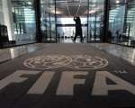 The logo of the FIFA is pictured on a carpet at the entrance of the FIFA headquarters in Zurich on February 6, 2010. Almost 100 African sports journalists have enrolled in the second phase of a training programme run by the AFP Foundation and sponsored by football's world governing body FIFA which kicks off today. Over two weeks, five-day workshops for reporters and photographers from all over the continent will be held in Dakar, Maputo, Nairobi and Rabat. Week-long follow-up sessions will take place in late April. AFP PHOTO / SEBASTIEN BOZON (Photo credit should read SEBASTIEN BOZON/AFP/Getty Images)