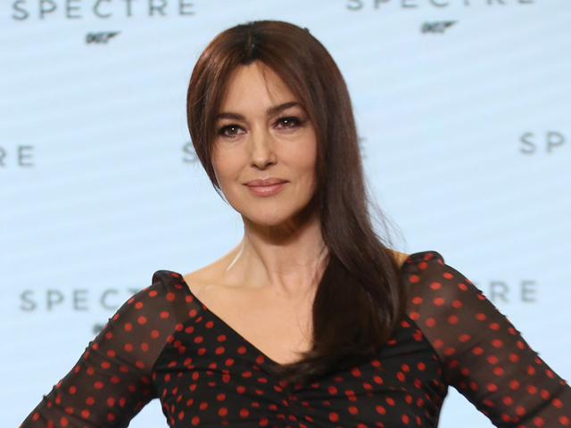 Actress Monica Bellucci poses for photographers at the announcement for the new Bond film, the 24th in the series, at Pinewood Studios in west London, Thursday, Dec. 4, 2014. (Photo by Joel Ryan/Invision/AP)