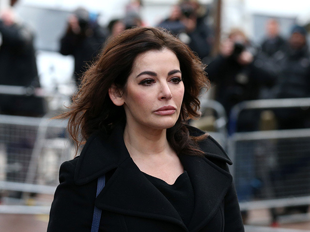 ISLEWORTH, ENGLAND - DECEMBER 05:  Nigella Lawson arrives at Isleworth Crown Court on December 5, 2013 in London, England. Italian sisters Francesca and Elisabetta Grillo, who worked as assistants to Nigella Lawson and Charles Saatchi, are accused of defrauding them of over 300,000 GBP.   (Photo by Oli Scarff/Getty Images)