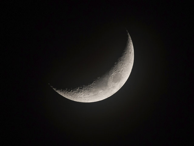 Waxing crescent Moon, slightly misty