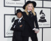 LOS ANGELES, CA - JANUARY 26:  Singer Madonna (R) and son David Banda Mwale Ciccone Ritchie attend the 56th GRAMMY Awards at Staples Center on January 26, 2014 in Los Angeles, California.  (Photo by Jason Merritt/Getty Images)