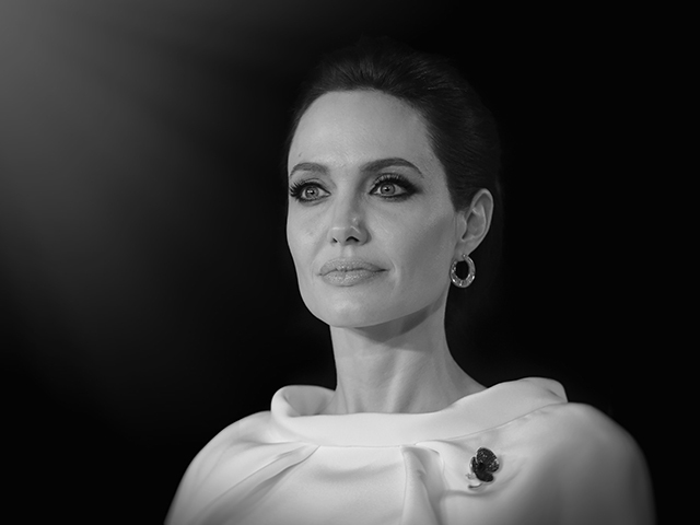 LONDON, ENGLAND - NOVEMBER 25:  (EDITORS NOTE: Image has been converted to black and white and digitally retouched) Angelina Jolie attends the UK Premiere of