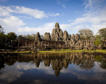 Smiling Stone Face of Bayon Temple at Angkor in Cambodia