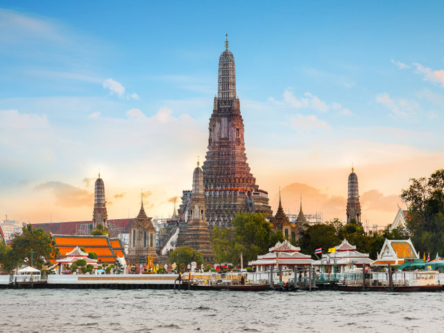 """Bangkok, Thailand - December 19 2014: Wat Arun is a socalled """"Temple of the Dawn"""" had existed at the site since the 17th century - time of the Ayutthaya Kingdom"""
