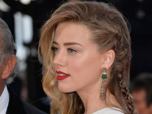 Amber Heard e seus penteados chiques e levemente bagunçados