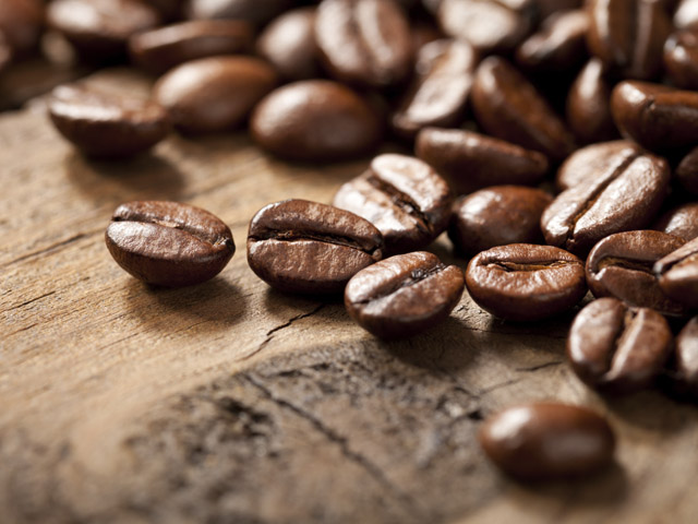Coffee beans on old wooden table