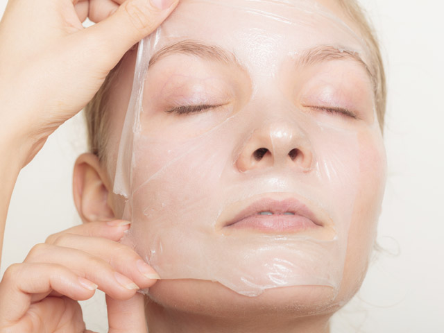girl removing facial peel off mask