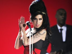 Amy Winehouse performs on stage at The BRIT Awards 2007 in association with MasterCard at Earls Court 1 on February 14, 2007 in London, England. (Photo by Dave Hogan/Getty Images)