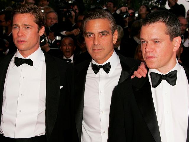 Com os BFFs Brad Pitt e Matt Damon || Créditos: Getty Images