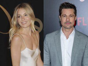 Sienna Miller e Brad Pitt foram vistos de mãos dadas em Festival no Reino Unido