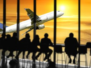 people in airport waiting for flight istock