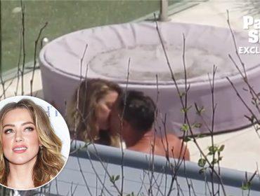 Solteira há quase dois meses, Amber Heard é flagrada beijando bonitão na Austrália