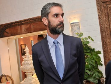 O advogado Augusto de Arruda Botelho se prepara para inaugurar novo escritório