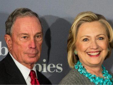 Candidato democrata à presidência dos EUA, Michael Bloomberg é visto conversando ao pé do ouvido com Hillary Clinton