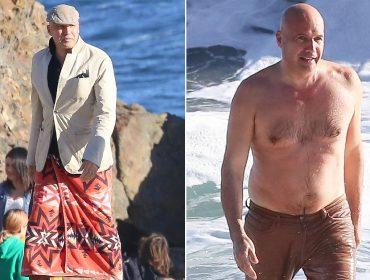 Billy Zane mergulha em praia de Malibu de calça e blazer e sob os olhares do bff Owen Wilson